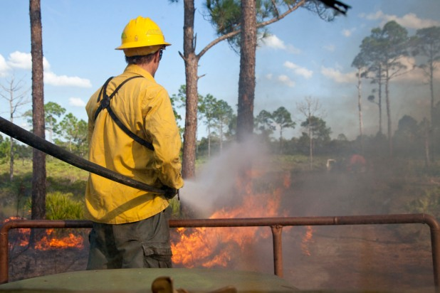 Dr. Pruett battles a rouge fire. Photo by Evan Barrientos